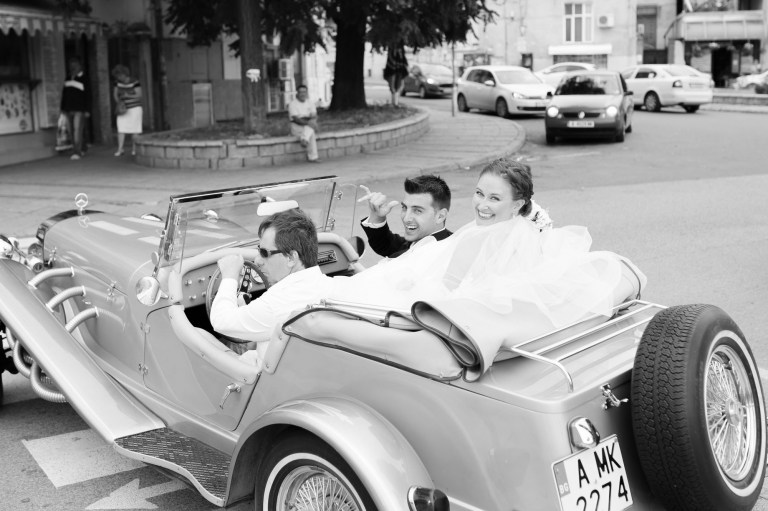 Burgas, Bulgaria bride and groom in vintage car after ceremony at the St. Cyril Cathedral