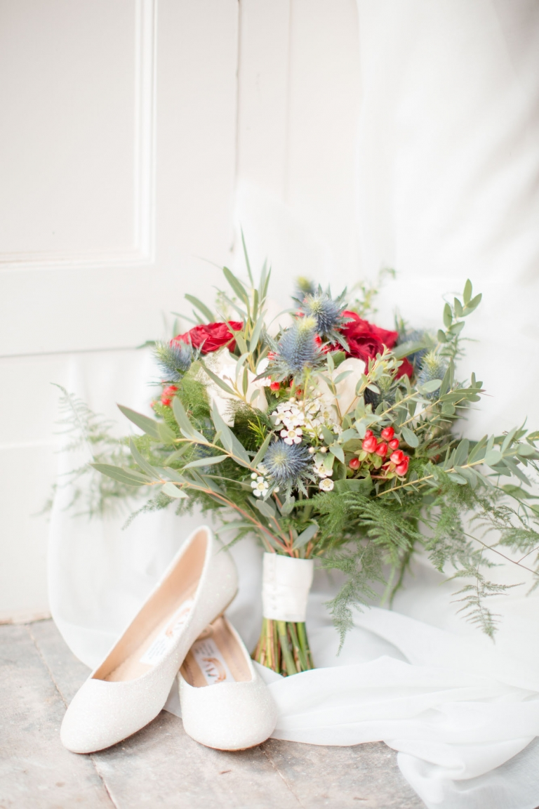 Aberdeenshire, Scotland wedding bouquet of thistles and red flowers with sparkly ballet flats