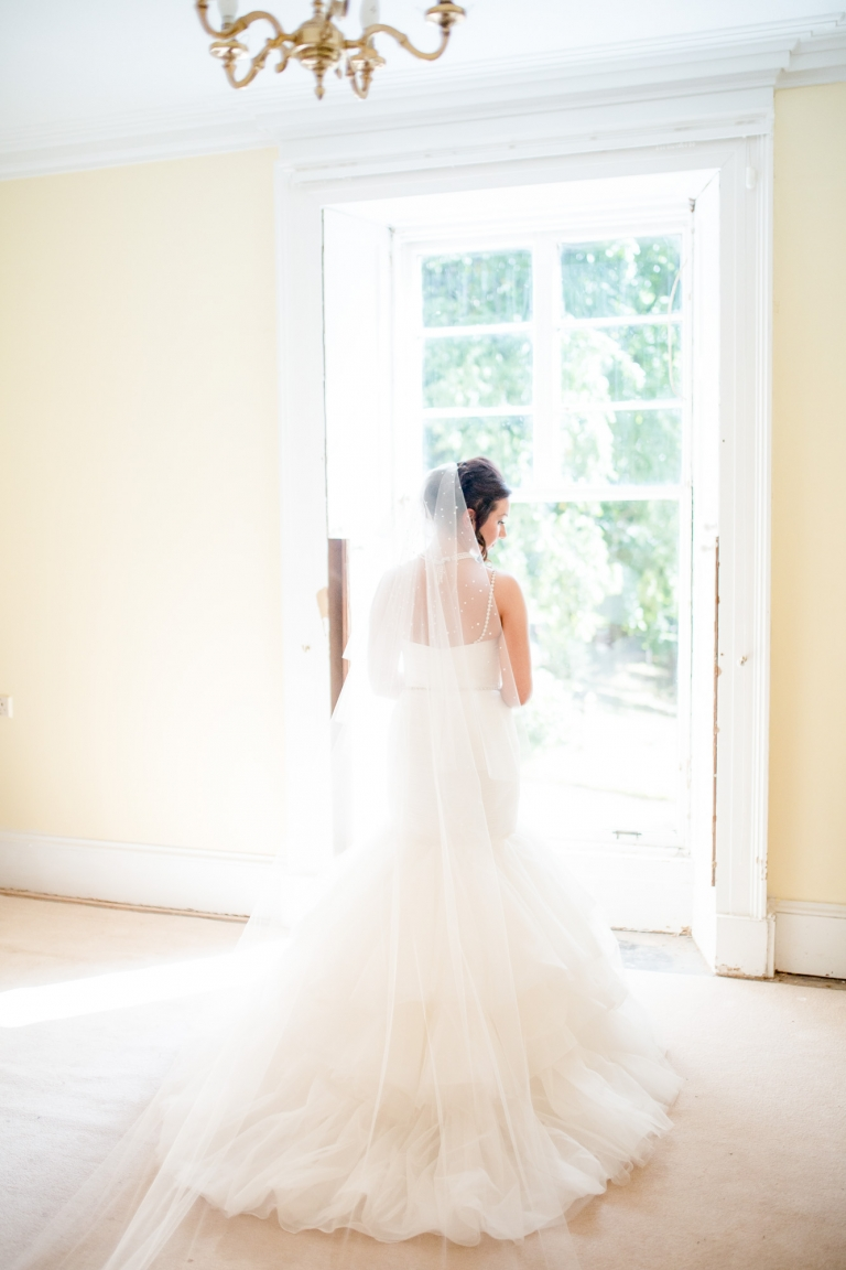 Aberdeenshire, Scotland bride in her home in Elgin with mermaid gown and cathedral veil